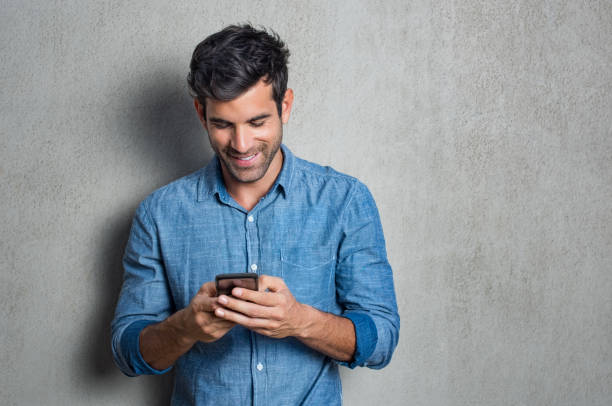 man texting on phone - text messaging stock photos and pictures