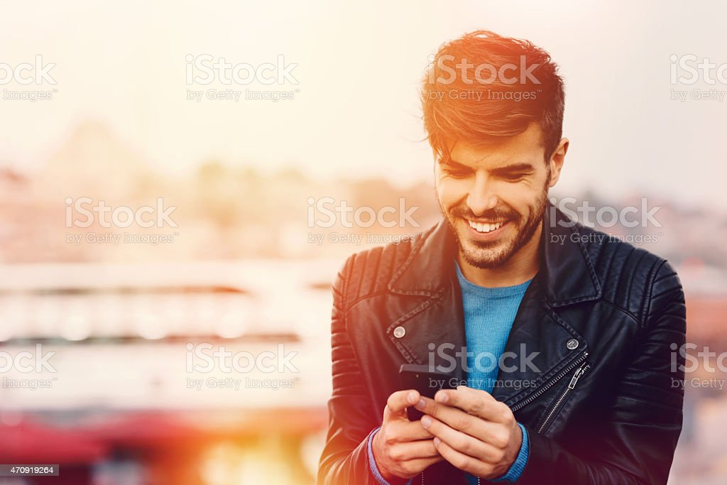 Man texting on smartphone stock photo