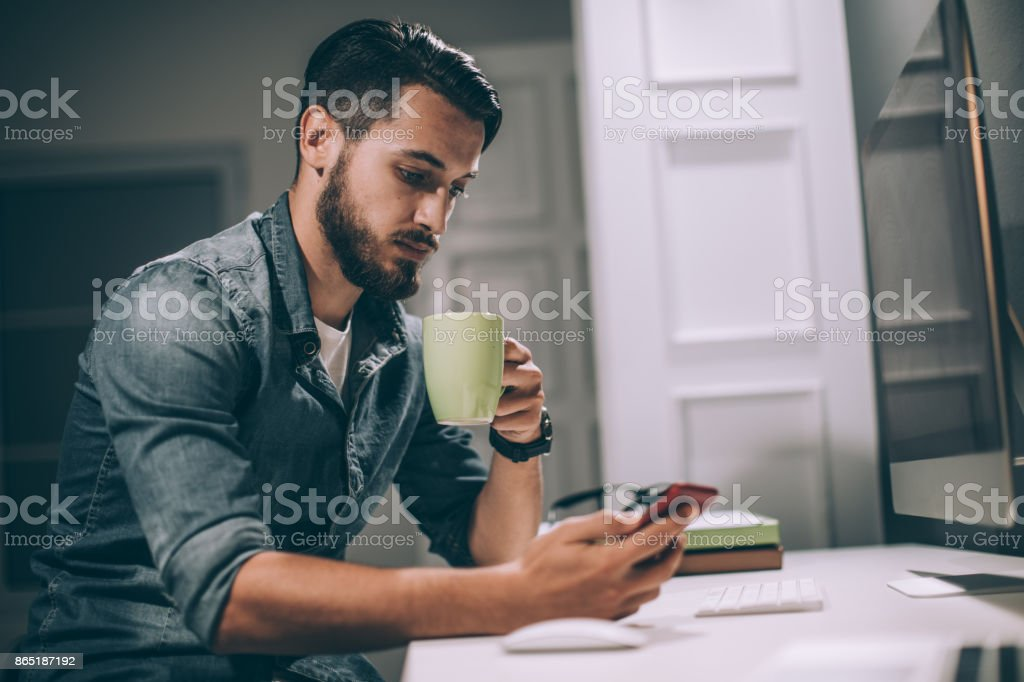 Man texting on the phone stock photo