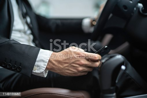Man texting while driving car