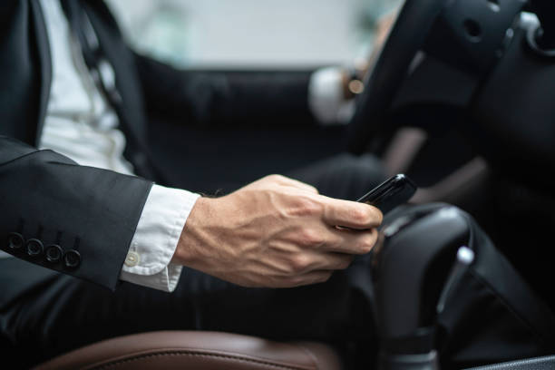 man texting while driving car - detraction stock pictures, royalty-free photos & images