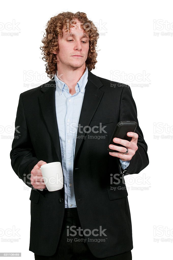 Man Texting with Coffee stock photo