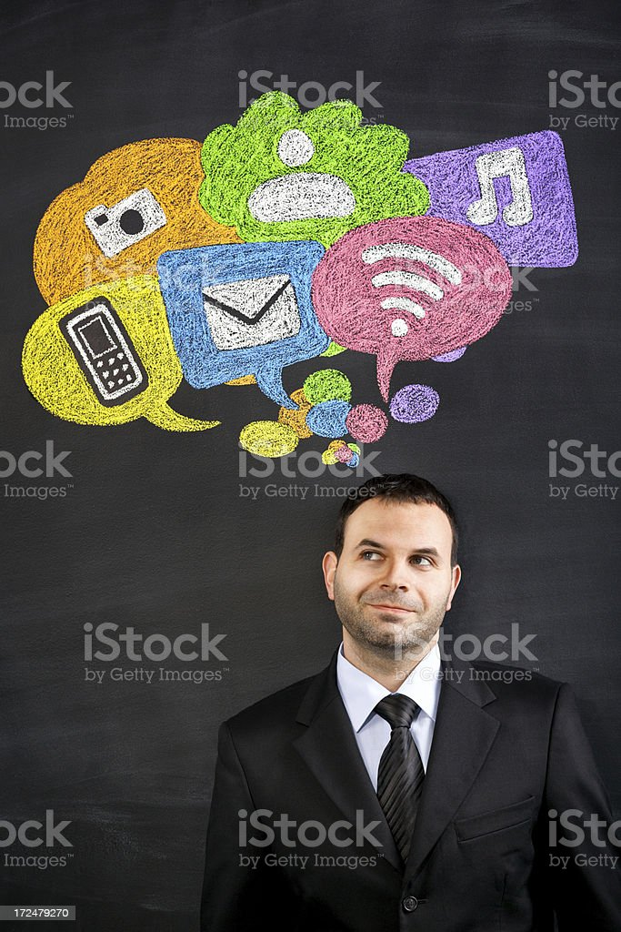 A man thinking about social media stock photo