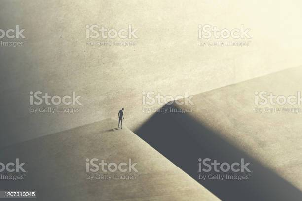 Photo of man thinking about taking big risk to reach the other side with a big jump