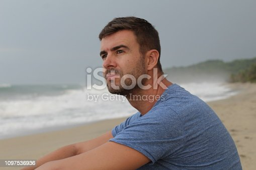 Man thinking at the beach with copy space.