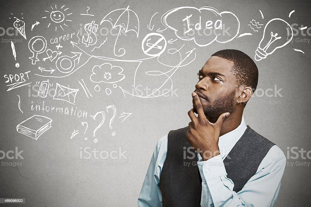 man thinking dreaming has many ideas looking up stock photo
