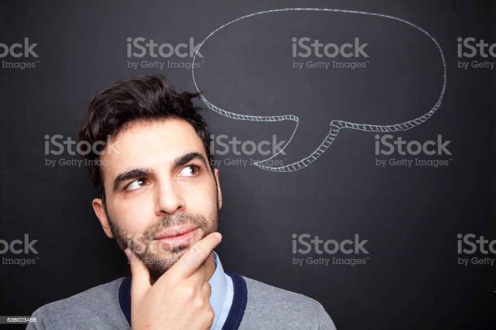 Man thinking hard in front of chalkboard stock photo