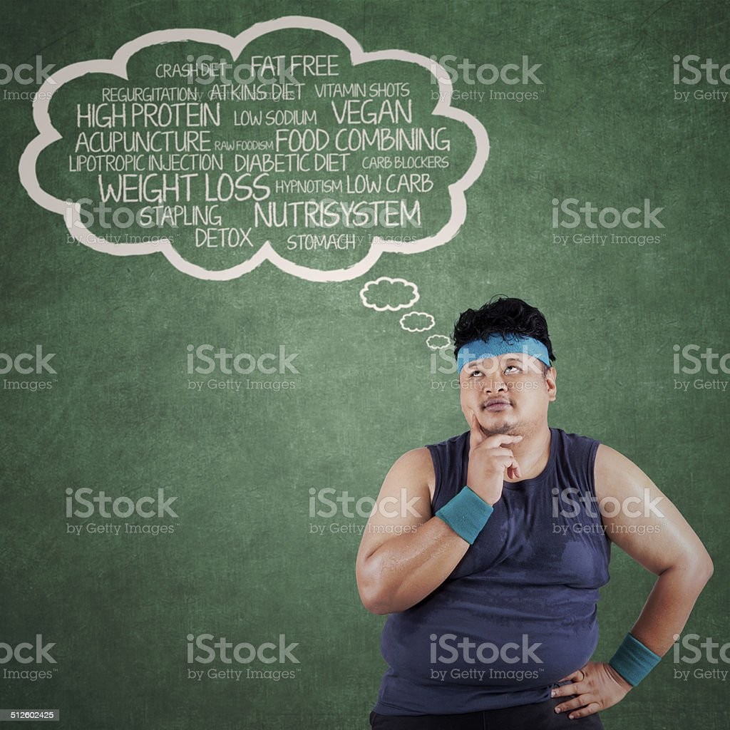 Man thinking the way to lose weight stock photo