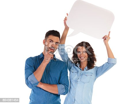854381780istockphoto man thinking while woman holds speech bubble over his head 854381454