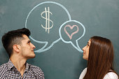 istock Man thinks about money and woman about love 174870380