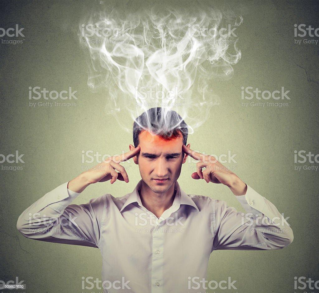 man thinks very intensely having headache stock photo