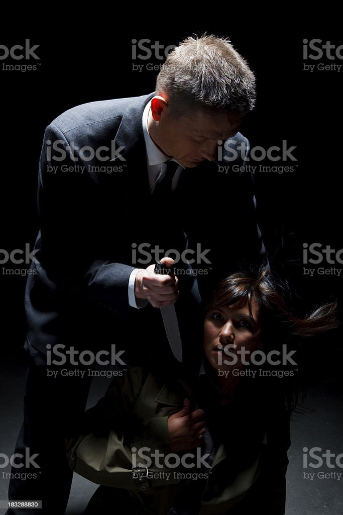 Man Threatening A Young Woman With His Knife royalty-free stock photo