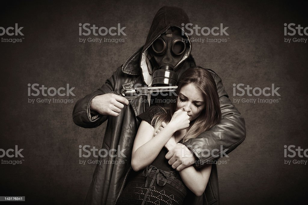 man threatening a young woman with pistol royalty-free stock photo