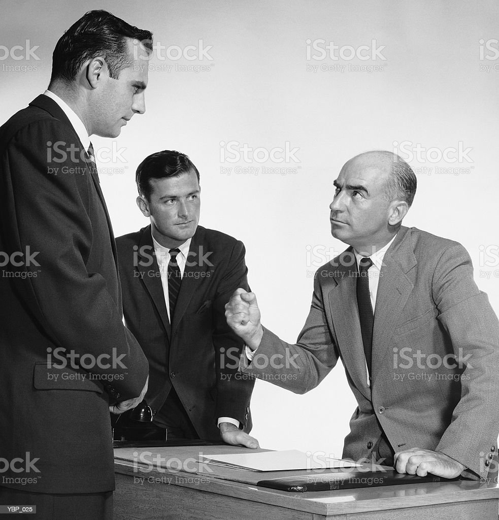 Man threatening two workers royalty-free stock photo