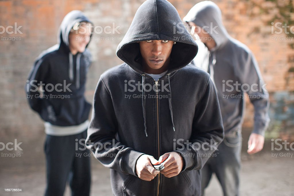 Man threatening with pocket knife stock photo