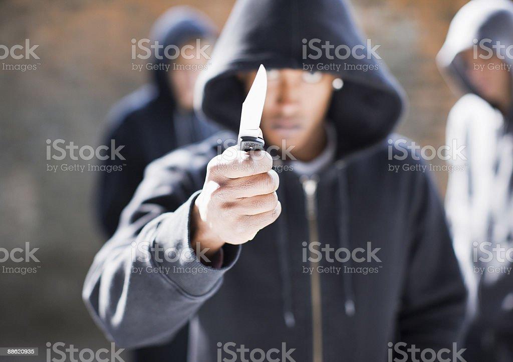 Man threatening with pocket knife royalty-free stock photo