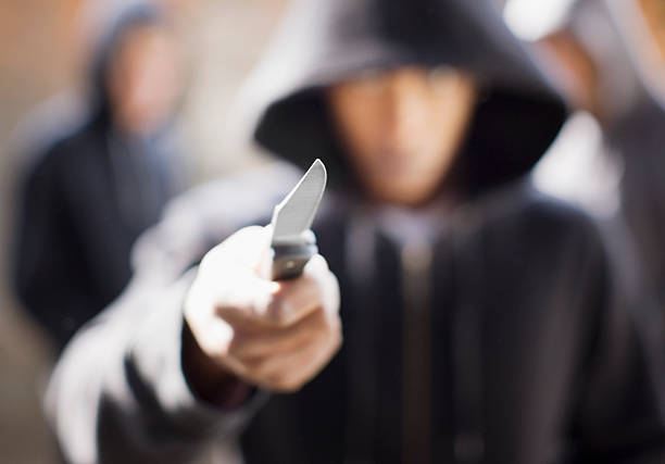 Man threatening with pocket knife  aggressively stock pictures, royalty-free photos & images