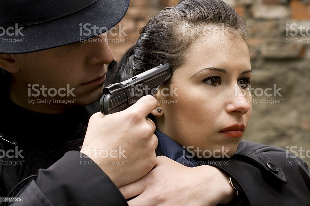 man threatens the woman with a pistol royalty-free stock photo