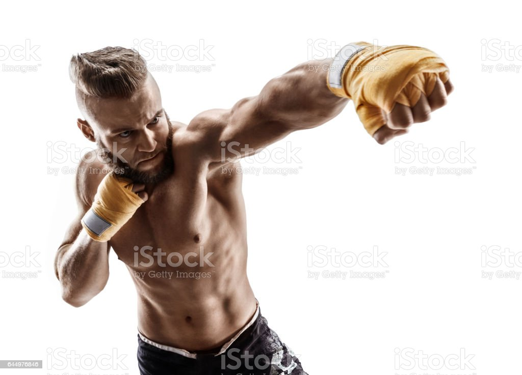 Man throwing a fierce and powerful punch. - foto de acervo