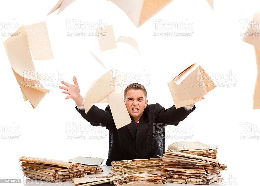 Man throwing away paperwork stock photo