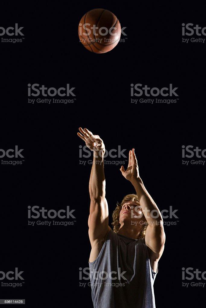 Man throwing basketball stock photo