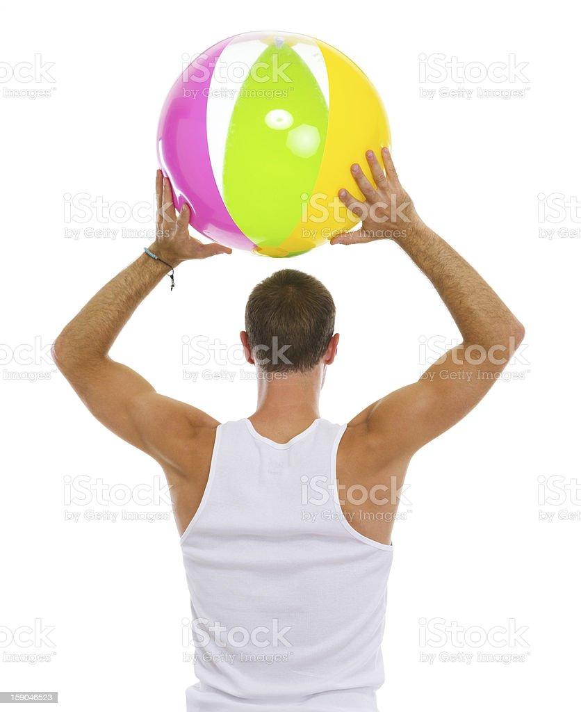 Man throwing beach ball. Rear view royalty-free stock photo