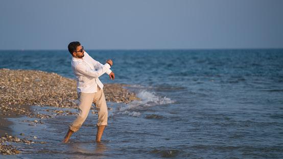 Man throwing rock in water