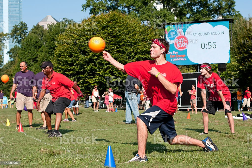 Man Throws At Opponent In Outdoor Dodge Ball Game stock photo