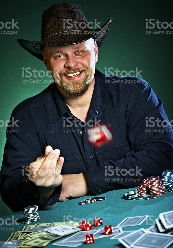man throws dice on a green background royalty-free stock photo