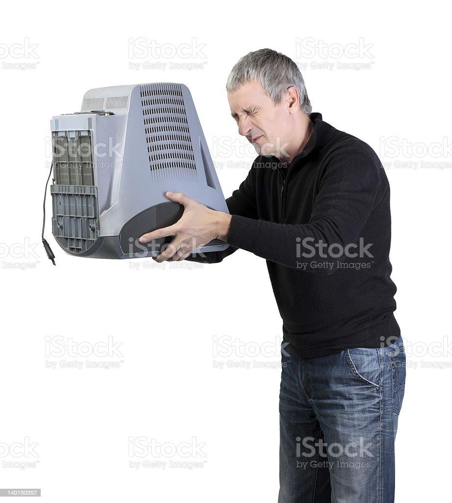 Man throws old TV stock photo
