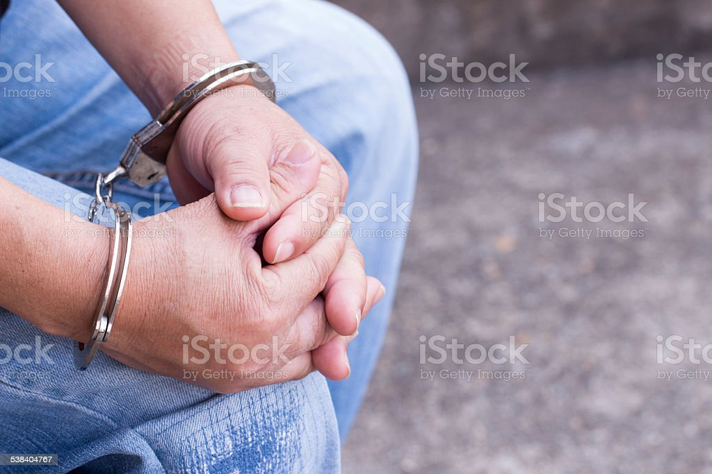 Man tied up in handcuffs stock photo