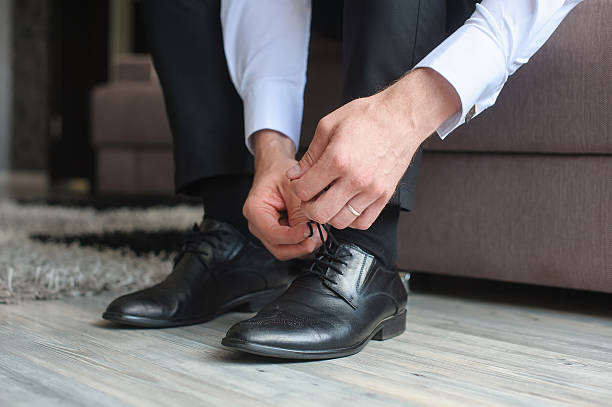Man ties his shoes. stock photo