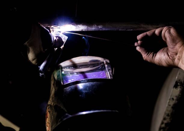 Man tig welding with brilliant bright white star burst bloom of light stock photo