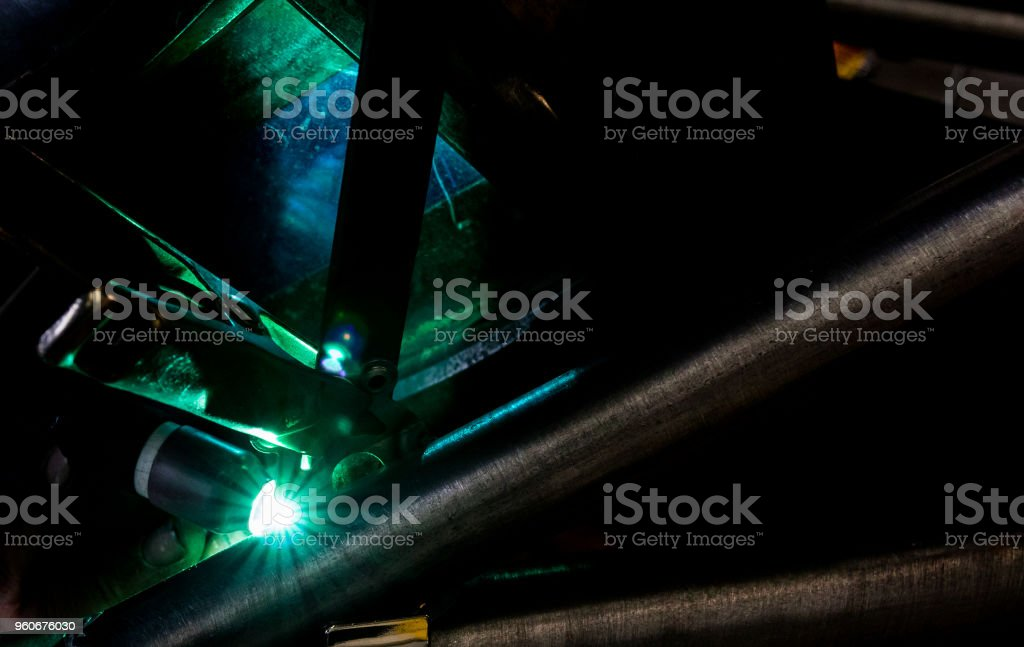 Man tig welding with brilliant bright white star burst blooms of lights stock photo
