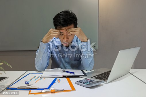 istock Man tired of working over time at late night 495663990