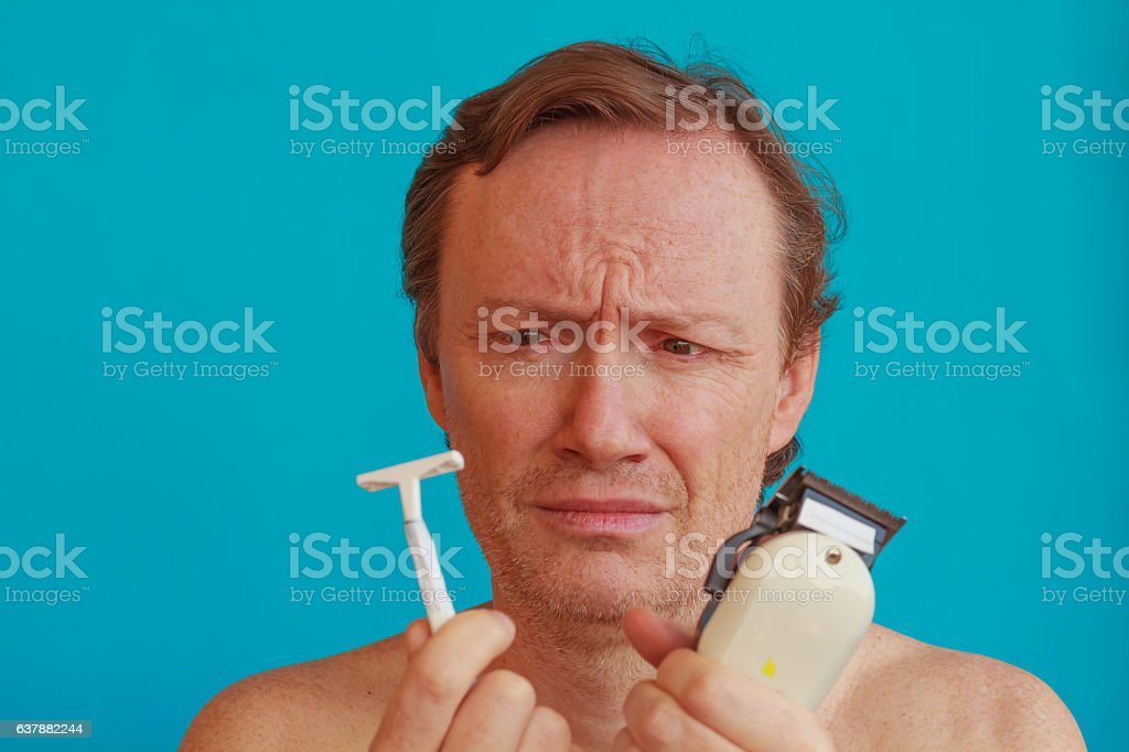 man to shave must choose between the razor and the razor-blade stock photo