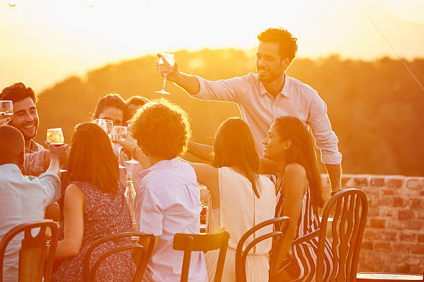 man toasting wineglass with friends at party - spain solar bildbanksfoton och bilder