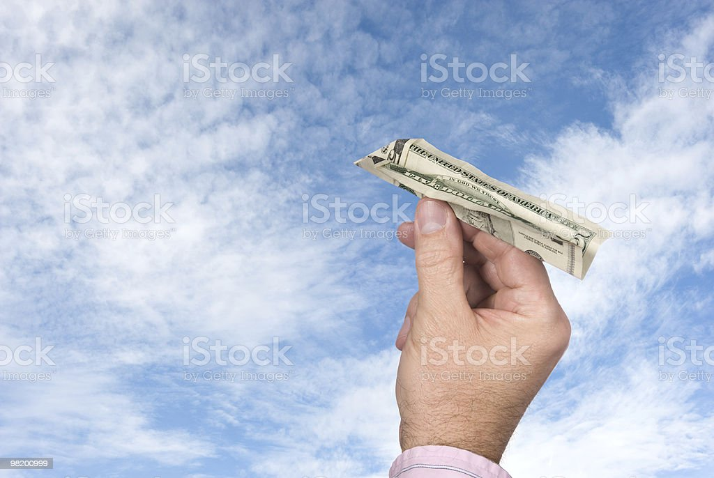Man tossing a paper plane royalty-free stock photo
