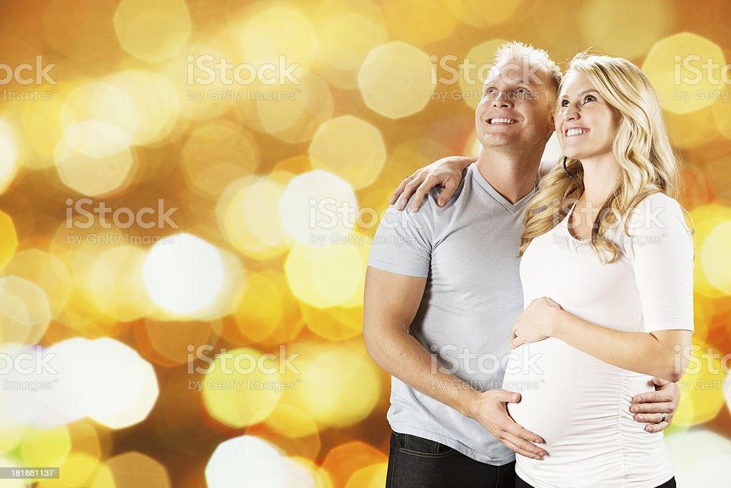 Man touching abdomen of his pregnant wife royalty-free stock photo
