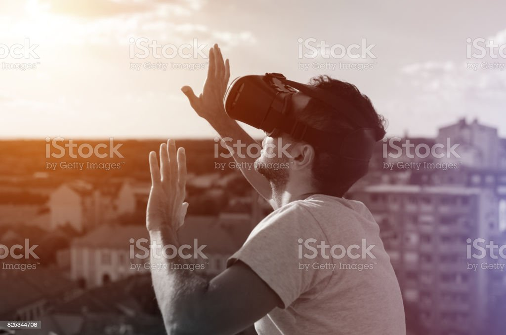 man touching and imagines better world with virtual reality headset stock photo