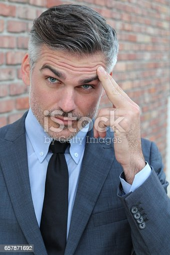 862431374 istock photo Man touching his forehead with worry 657871692
