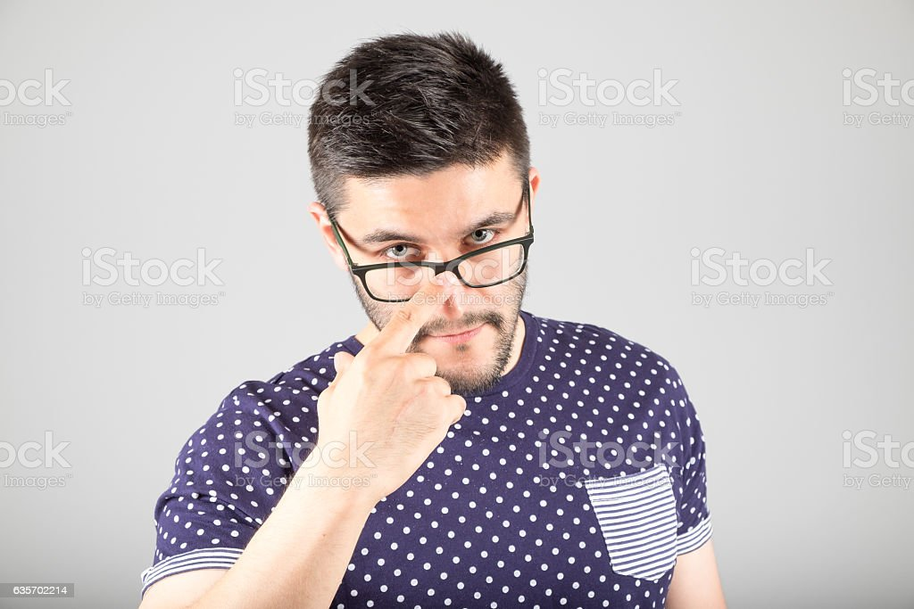 Man touching his glasses royalty-free stock photo