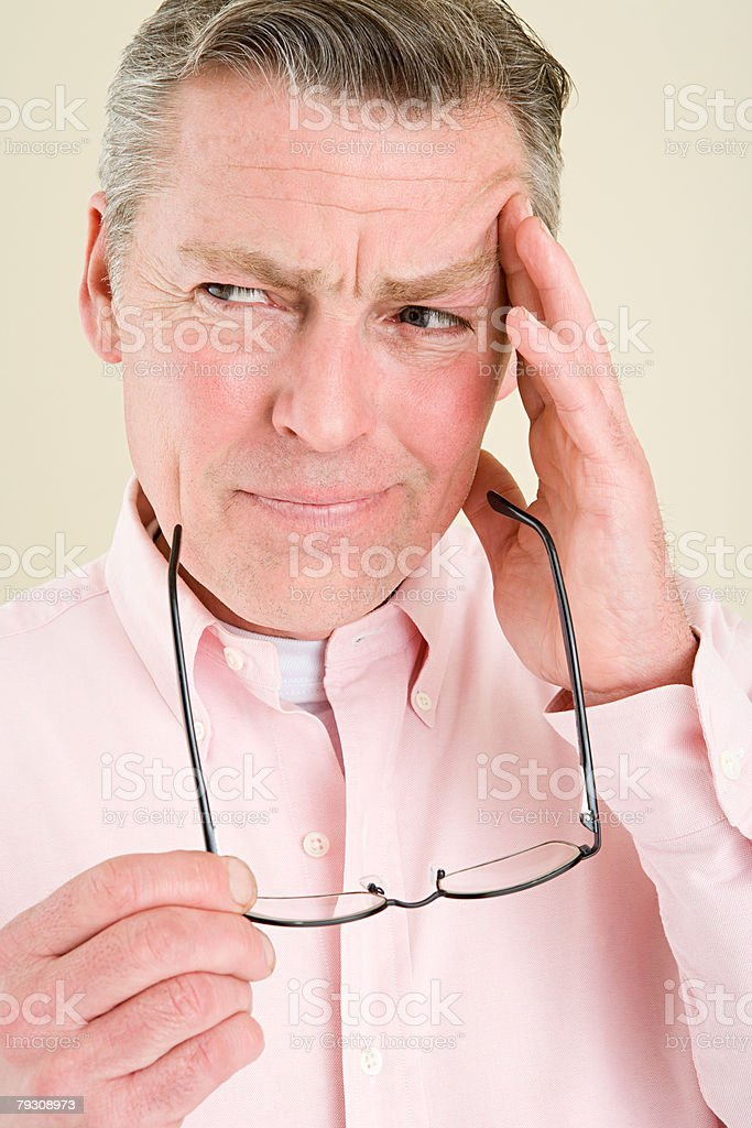 A man touching his head 免版稅 stock photo