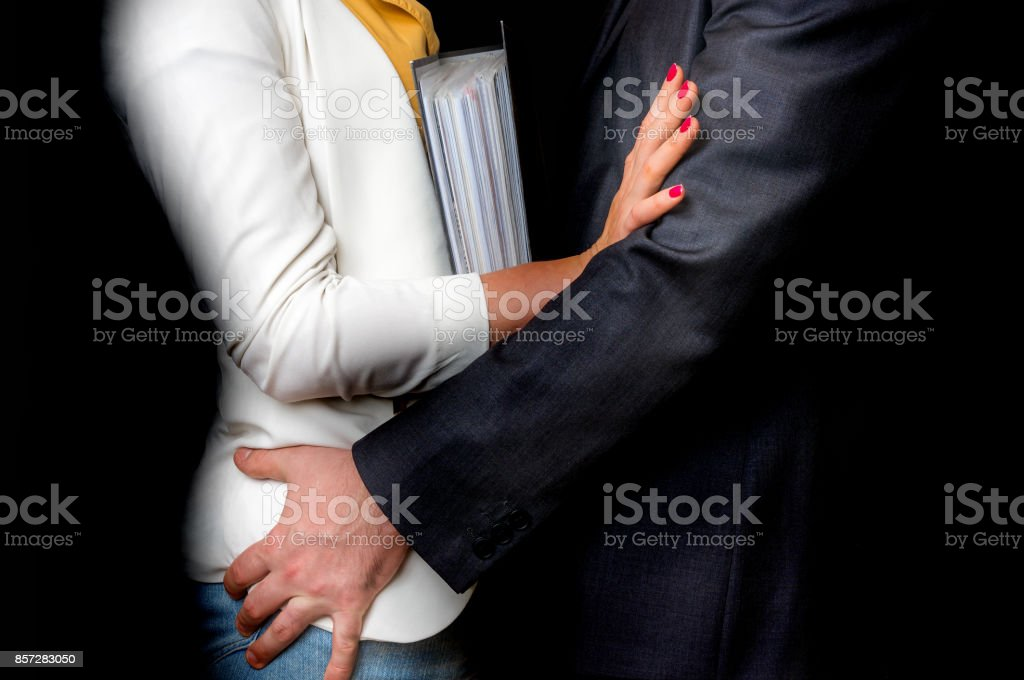 Man touching woman's butt - sexual harassment in office - foto stock