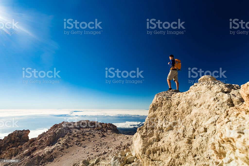 Man tourist hiker or trail runner looking at view. stock photo