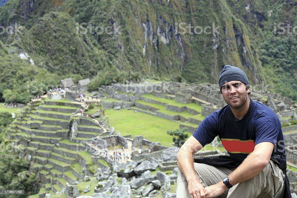 Man Tourist Sitting at Machu Picchu, Peru royalty-free stock photo