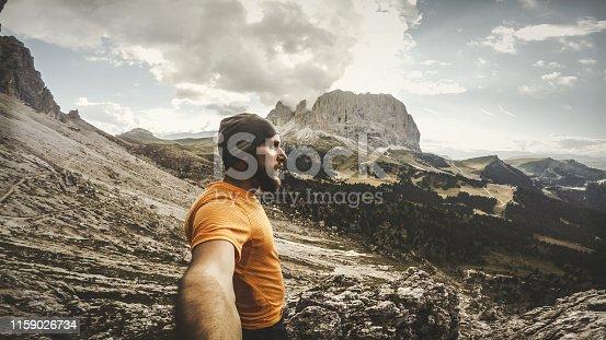 Man trail running on Dolomites high mountain