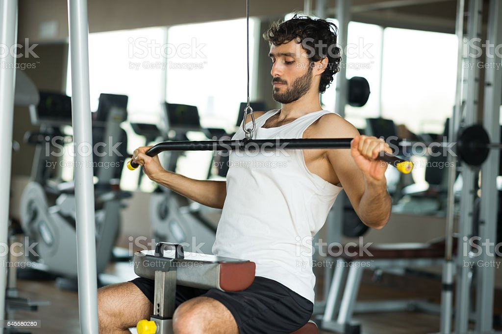 Man training hard in a gym stock photo