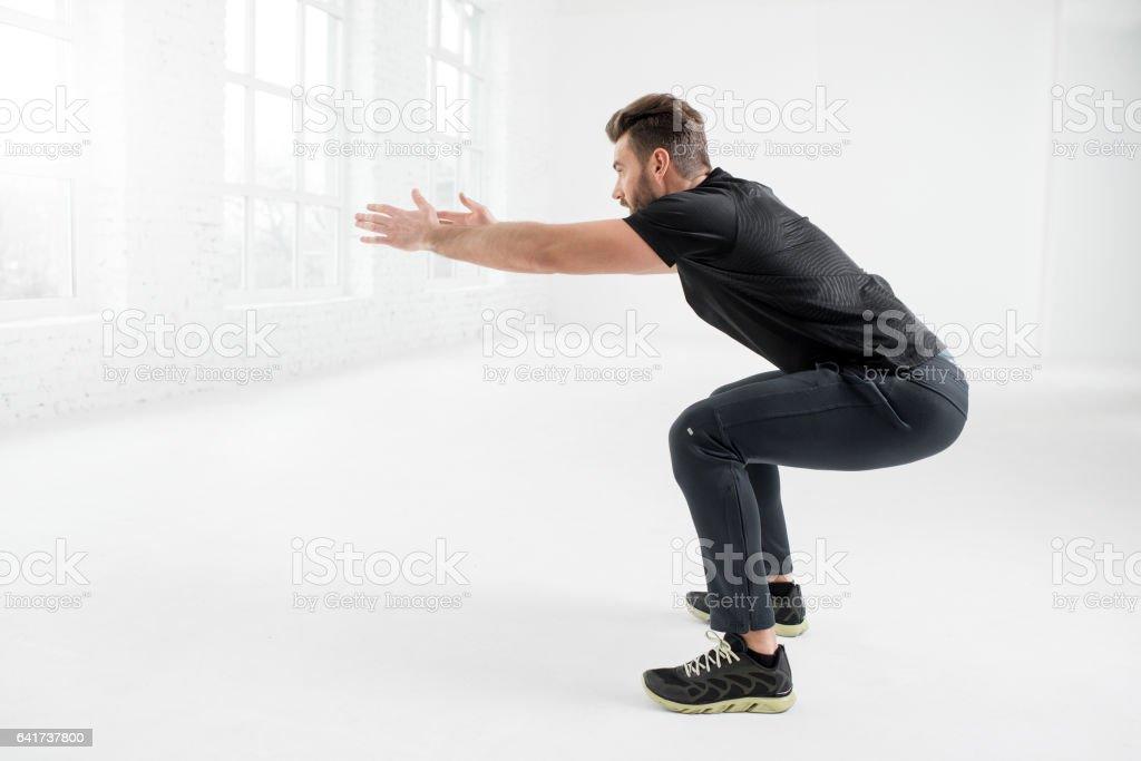 Man training indoors stock photo