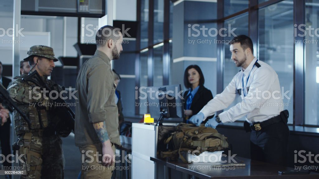 Man transitting weapon standing in airport stock photo